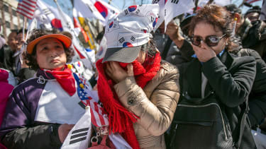 Supporters of President Park Geun-hye cry when she is impeached