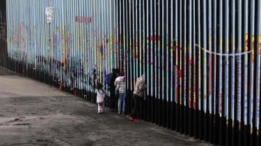 A family at the U.S.-Mexico border.
