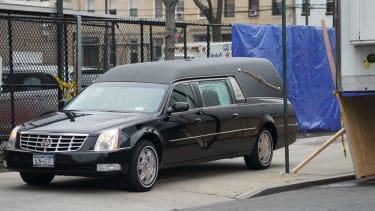 A hearse picks up a body at a New York hospital.