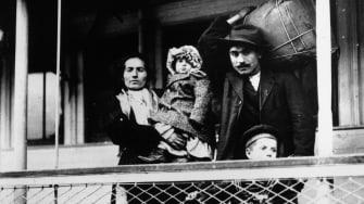 An Italian family prepares to pass through Ellis Island, 1905.
