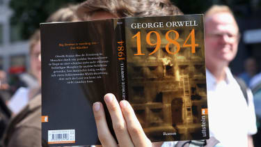 A German protester pointedly holds up a copy of 1984.