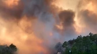 Wildfire rages in Florida