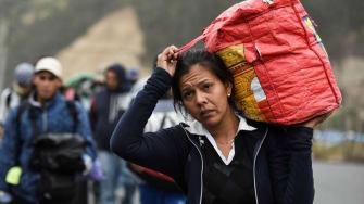 A Venezuelan migrant walks along the road.