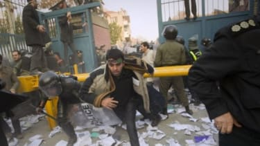 Police chase protesters at the gate of the British embassy in Tehran: Hundreds of protesters stormed Britain's diplomatic compound on Tuesday, apparently to protest recent financial sanctions