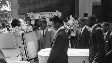 Pallbearers carry the tiny casket of Tanya Blanding