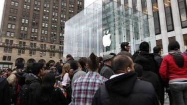 People swarm around the Apple flagship store in New York before the iPad 2's release last March
