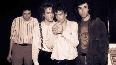 The Replacements (Chris Mars, Paul Westerberg, Slim Dunlap, and Tommy Stinson) pose together.