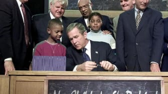 George W. Bush at a signing ceremony for the No Child Left Behind Act.