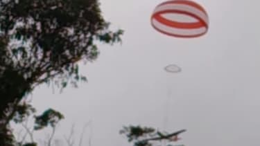 Watch this plane crash saved by a parachute