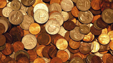 Insurance company pays $21,000 of settlement in massive buckets of change