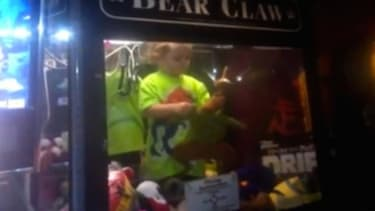 Boy becomes ultimate prize after he crawls inside of a toy claw machine