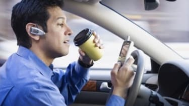"""Drivers are going to find distractions, says Holman W. Jenkins, Jr. at """"The Wall Street Journal,"""" whether it is the cell phone, coffee or a breakfast on the run."""
