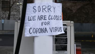 A sign at a gas station alerts customers that a business in Queens is closed on April 03, 2020