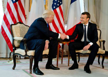 President Trump shakes hands with Emmanuel Macron in Brussels