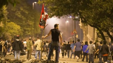 A protestor looks on during clashes with Turkish police near Prime Minister Recep Tayyip Erdogan's office in Istanbul, on June 4.
