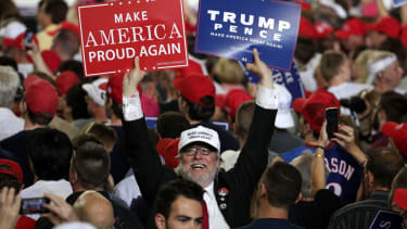 Trump supporter holding signs.