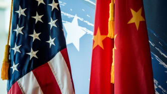 US and Chinese flags.