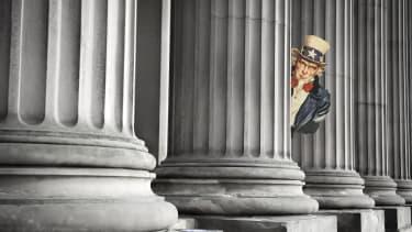 Uncle Sam peeks out from courthouse columns