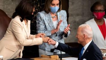 Biden and Vice President Kamala Harris bump fists