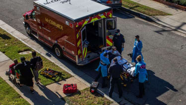 A patient is loaded into an ambulance in Hawthorne, California.