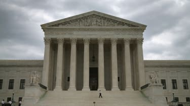 http://www.gettyimages.com/detail/news-photo/guards-stand-in-front-of-the-supreme-court-building-august-news-photo/453873568