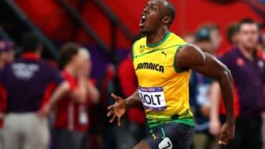 Jamaica's Usain Bolt celebrates his gold in the Men's 100m, Aug. 5