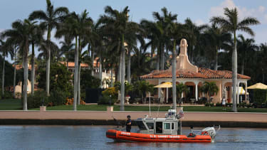 A Coast Guard boat drifts off Mar-a-Lago.