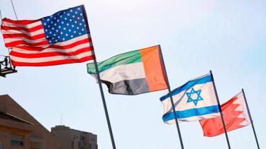 U.S., UAE, Israel, Bahrain flags.