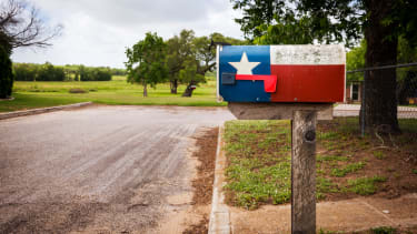 A mailbox painted with the Texas flag.