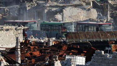 Buses await safe passage from Aleppo, Syria