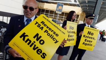 United Airlines flight attendants picket in front of Tom Bradley International terminal in Los Angeles on April 1 in opposition to the earlier decision to allow small knives on planes.
