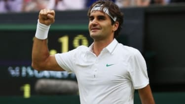 Roger Federer knocked out defending champion Novak Djokovic to become the first man to reach eight Wimbledon singles finals.