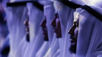 Men wearing traditional Emirati head coverings.