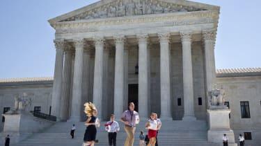 Interns run to deliver a Supreme Court decisions.