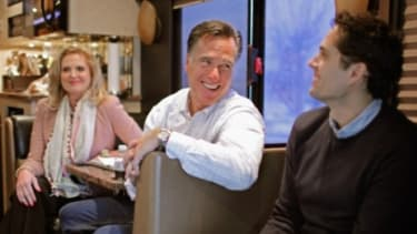 Mitt Romney and his family aboard the campaign bus: A new Pew survey suggests that conservative Americans have a better grasp of politics and history than do liberals.