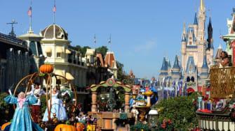 A parade goes down Main Street at the Magic Kingdom.