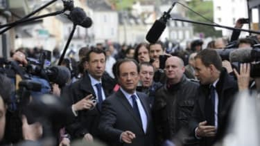 French presidential frontrunner Francois Hollande arrives at a polling station in Tulles to cast his ballot in the first round of elections on Sunday.