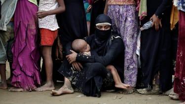 Rohingya refugees wait to receive aid in Cox's Bazar, Bangladesh.