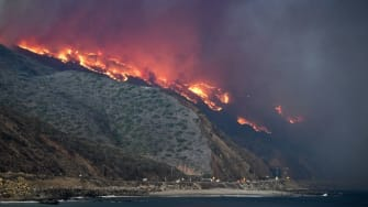 The Woolsey Fire reaches the Pacific Ocean.