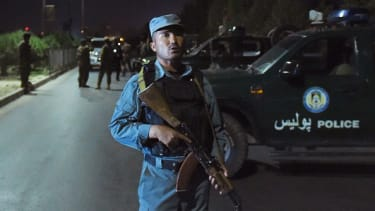 An Afghan police officer outside the American University of Afghanistan in Kabul.