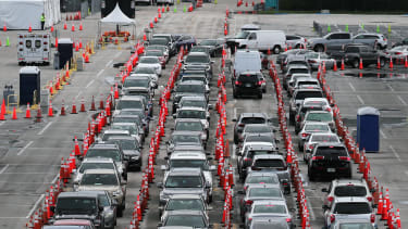 Cars wait in line at a coronavirus testing site