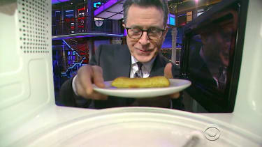 Stephen Colbert uses the microwave camera prop
