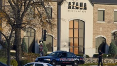 Police personnel work outside the Azana Salon and Spa in Brookfield, Wis., where three people were killed and four others wounded after a mass shooting on Sunday.