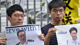 Hong Kong protest leaders Nathan Law, Joshua Wong, and Agnes Chow