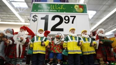 Santa Claus figurines are displayed at the Wal-Mart store November 20, 2007 in Secaucus, New Jersey.