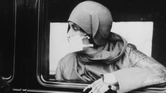 Women wearing flu masks