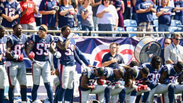 New England Patriots kneel during the national anthem