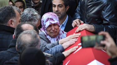 Mourners grieve following a New Year's attack in Istanbul