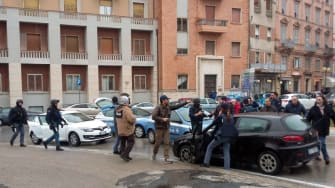The black car Alfa Romeo of young man suspected of wounding several foreign nationals in a drive-by shooting,is blocked by police and Carabibieri enforcement at Macerata, on 3 February 2018