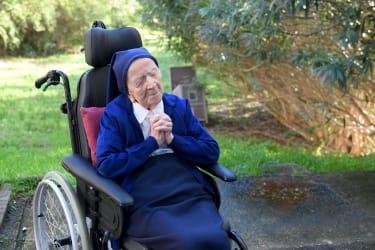 Sister Andre prays